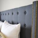 Tufted headboard with arms